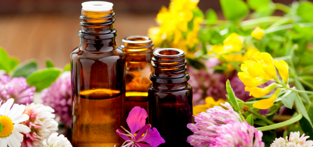 Image of three essential oils with spring flowers