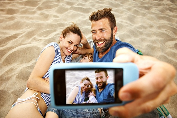 The millennial parent rules work from home, give the kids funny names, take family selfies